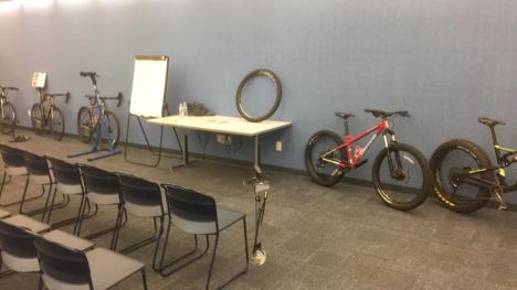 Hometown Bicycles set up bicycles at Howell Carnegie Library for a bicycle clinic