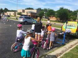 Hometown Bicycles at Hilton Elementary teaching Safety Town