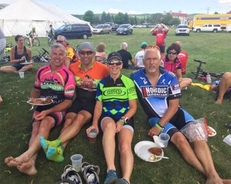 Team Hometown Bicycles' Joe Van Gordon, Deb Godmer, and Rex Blair with John Clark at Michigan Mountain Bike Mayhem 2017