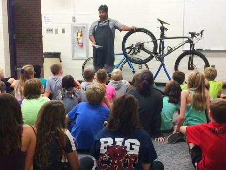 Shaun Bhajan of Hometown Bicycles teaching the mechanics of bicycles to Pinckney's Navigator Elementary students