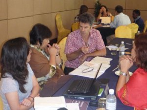 Penang workshop participants work in small groups to discuss their roles