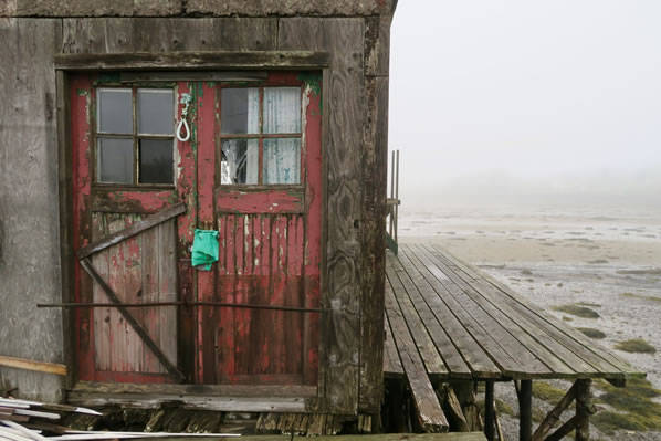 Old boat house in the fog
