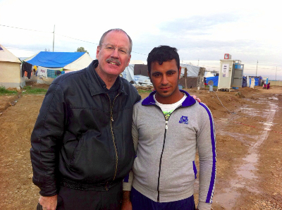 Ministry partner with a Kobane refugee in Iraq.