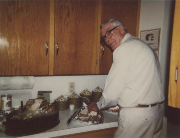 My grandfather, carving a Thanksgiving turkey