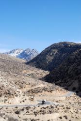 The twisty road downhill towards Farashband