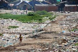 A young boy wandering through the dump