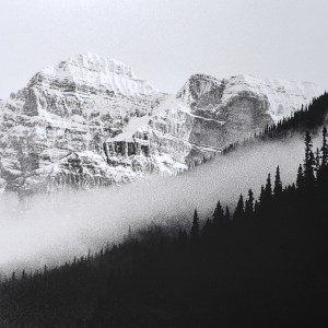 Morning fog settles into mountain valley in the Canadian Rocky Mountains. B&W handcrafted alternative process photograph (original silver emulsion print from paper negative). © WJ Eastman Offered by GALLERY5X7