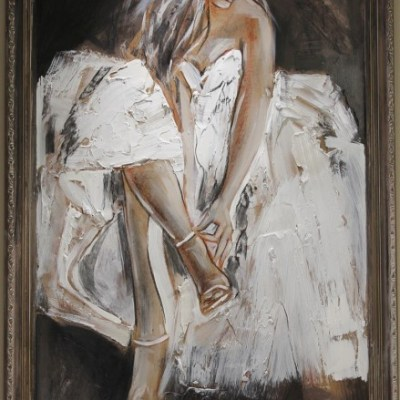 framed painting of woman in white dress