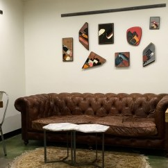 Living Room Clocks Next Storage Ideas S 003 Three Brothers Coffee Nashville Tn Gallerymonthly Bikes Are Hoisted On Walls A Hammock Chair Swings In The Corner Hiking Guides Sit To Biking Books Rough Hewn Wooden Shelves And Almost Every Art