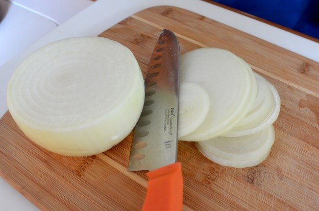 sliced onions with knife