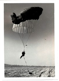Emergency situation where the reserve (white chute) opened on the (main green) T-10 parachute.
