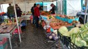 This grocer was selling produce at an open-air market held on Saturdays
