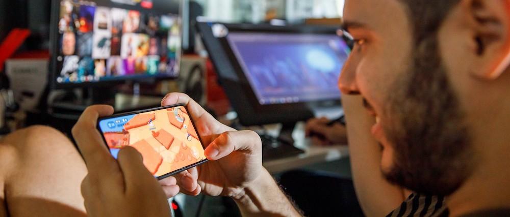 Man playing mobile game