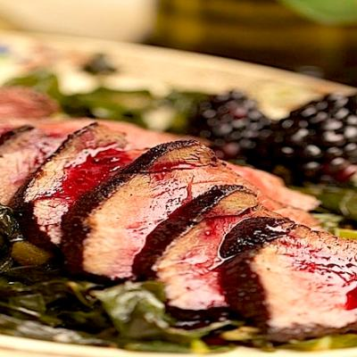Chili Cocoa Crusted Venison with Berry Reduction
