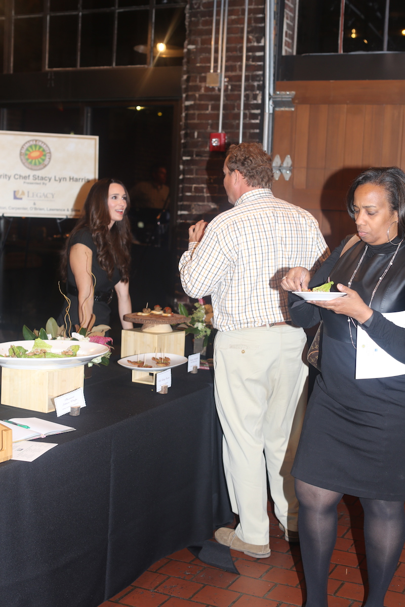 Stacy Lyn talking with one of the donors toward Baptist Health Charity Event.