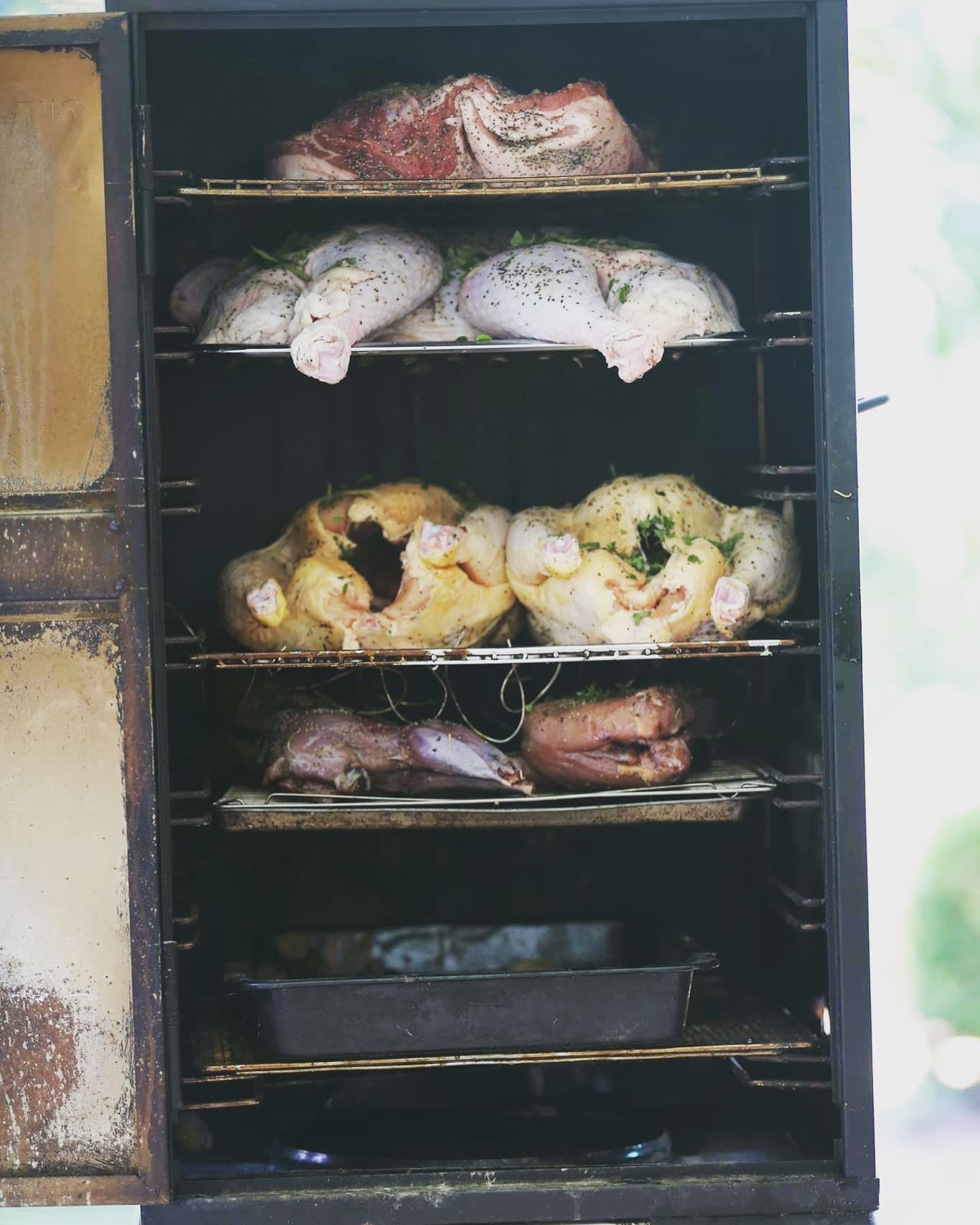 There's just nothing like a smoker packed out with meat.