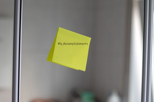 A note on a mirror listing accomplishments.
