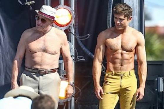 "51726116 Actors Zac Efron and Robert De Niro take off their shirts for a ""Flex Off"" contest for a scene in their new movie ""Dirty Grandpa"" on April 30, 2015 in Tybee Island, Georgia. The new comedy tells the story of an uptight guy who is tricked into driving his grandfather, a perverted former Army general, to Florida for spring break. FameFlynet, Inc - Beverly Hills, CA, USA - +1 (818) 307-4813"