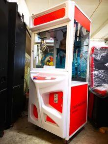 Branding on arcade claw machine