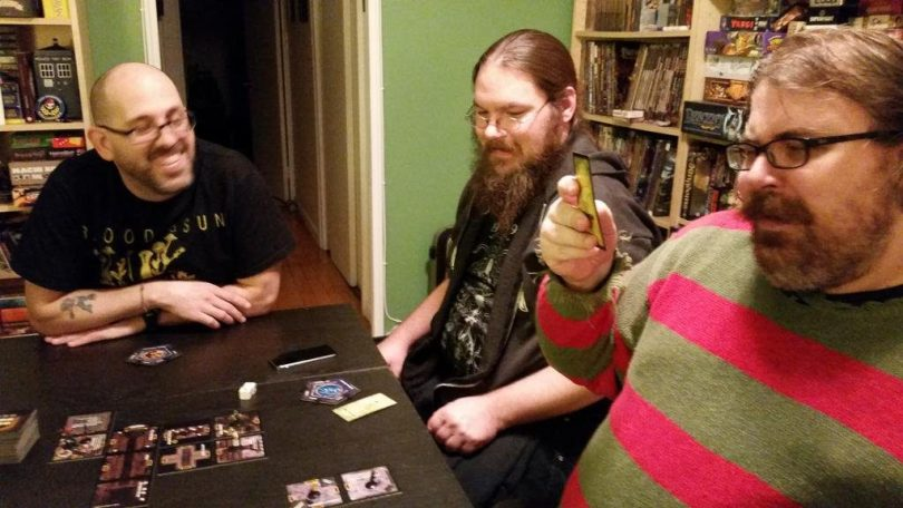 Board games bring together folks of all kinds of facial hair!