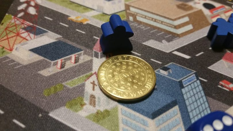 The manhole covers are actually really nice custom metal coins.