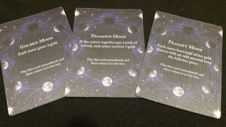 Improvement cards aren't the only thing which demand cooperation - the Moon cards, drawn randomly and triggering immediately, will either bring weal or woe, but will often call for the sisters to act as one for maximum benefit.