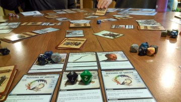 What was played: Pathfinder TCG Who played it: The normal Monday group Why: Because it's Monday! +1 rolls: Sometimes this game feels like Pokemon (to continue with the catch 'em all theme). Though, we don't have to deal with basic items anymore. We didn't realize we could have been banishing basic cards as we ran across them. So now, we are playing catch up .