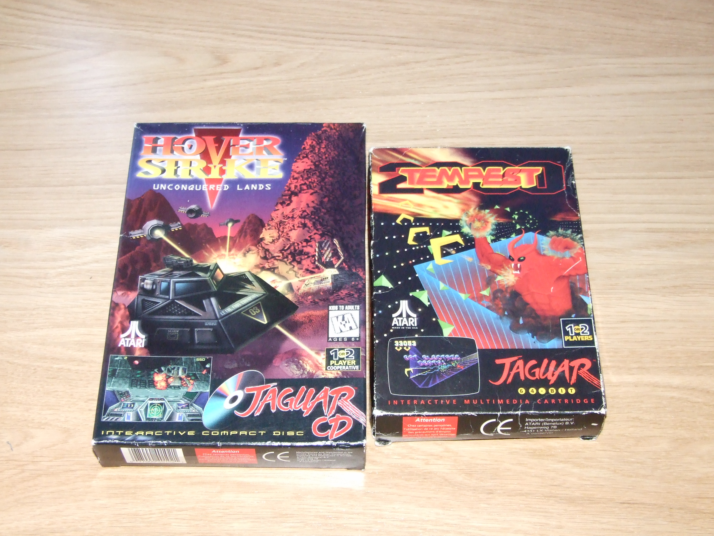 Hover Strike: Unconquered Lands for the Atari Jaguar CD box, compared with the box of Tempest 2000, side by side.