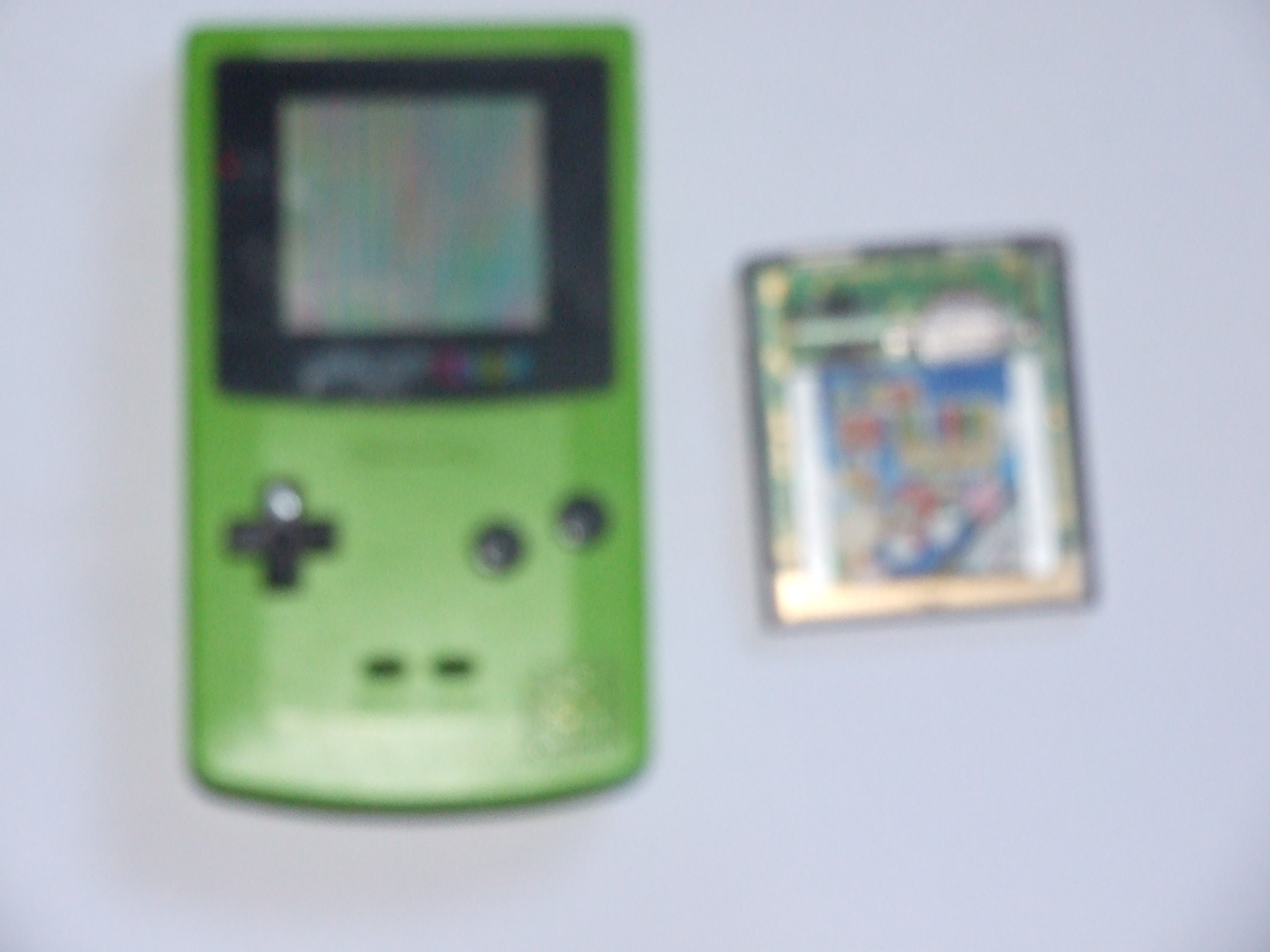 Game Boy Color and Super Mario Bros. Deluxe cartridge together