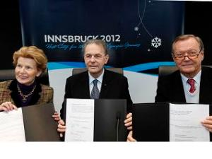 IOC President Jacques Rogge (centre) attends host city contract signing for the Innsbruck 2012 Olympic Youth Games