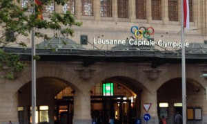 "A sign over the Lausanne Train Station boast its ""Olympic City"" status (GB Photo)"