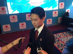 Sochi 2014 Bronze Medalist figure skater and Almaty 2022 Ambassador Denis Ten takes questions from reporters in Almaty (GamesBids Photo)