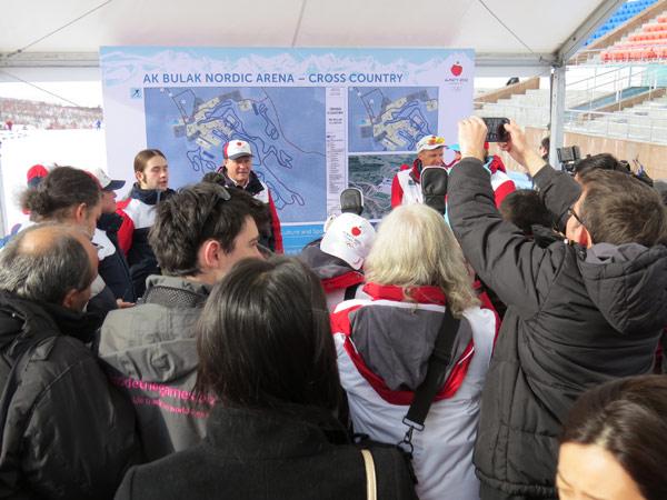 Scores of Domestic and International Media Surround Presenters at the Ak Bulak Nordic Arena During Almaty 2022 IOC Visit (GamesBids Photo)