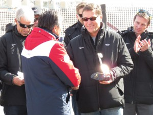 IOC Evaluation Commission Chief Alexander Zhukov receives souvenir at iconic Madeu ice rink in Almaty (GamesBids Photo)