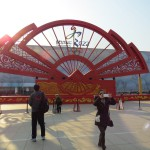"Tourists admire Beijing 2022 branding in front of ""Water Cube"" National Aquatic Centre, proposed curling venue (GamesBids Photo)"