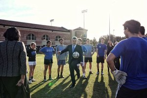 IOC President Thomas Bach practices soccer with students at UCLA (LA 2024 Facebook Photo)