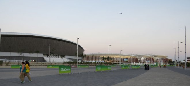 The velodrome (left) and other Rio 2016 Olympic Park venues seem ready for spectators Saturday. They're under the watch of a security helicopter above (GamesBids Photo)