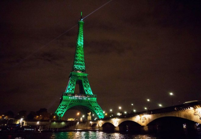Eiffel Tower in Paris lit up green to mark beginning of the Paris Agreement