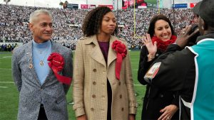 LA 2024 Athletes' Advisory Commission members (right to left)Janet Evans, Allyson Felix and Greg Louganis preside over coint toss at Rose Bowl game (LA 2024 Photo)