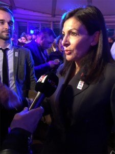 Paris Mayor Anne Hidalgo answers reporters questions at a Paris 2024 reception Saturday night (GamesBids Photo)