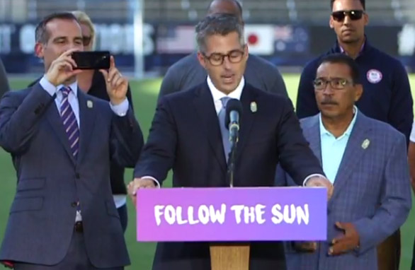 LA Mayor Eric Garcetti snaps a picture of LA 2024 Bid Chair Casey Wasserman at announcement event (Facebook Live Screen)
