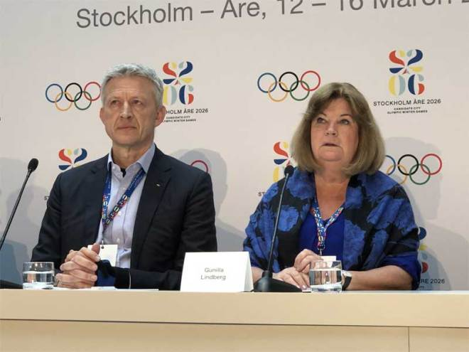 IOC Evaluation Commission Chair Octavian Morariu (left) and Swedish Olympic Committee Secretary General Gunilla Lindberg discuss Sweden's 2026 Olympic bid with media (GamesBids Photo)