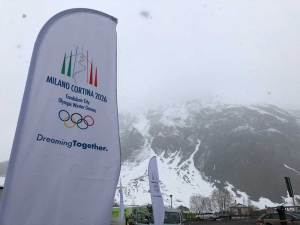A Milano-Cortina 2026 Olympic bid promotional banner in Livigno, where snowboard and freestyle ski events are proposed (GamesBids Photo)