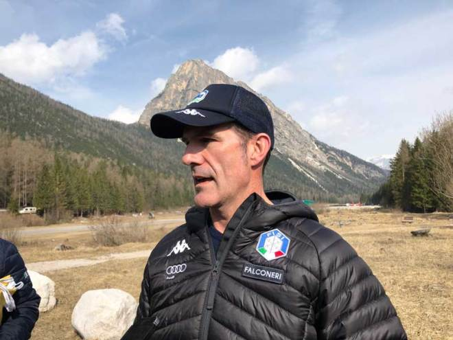 Armin Zöggeler, a six time Olympic medalist and two-time Olympic champion in luge discusses Cortina Olympic Village at the proposed site (GamesBids Photo)