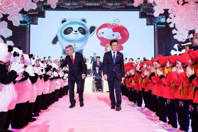 IOC President Thomas Bach helps introduce Beijing 2022 Olympic mascot Bing Dwen Dwen the panda, and Paralympic mascot Shuey Rhon Rhon, a lantern child (IOC Photo)