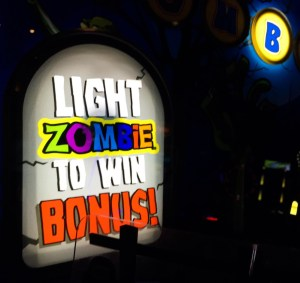 zombie snatcher arcade game bonus sign at dave and buster's