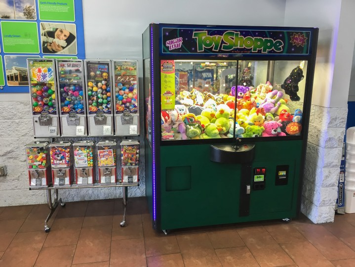 image of claw machine next to toy vending machines
