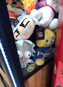 view of available plushes in an arcade crane machine