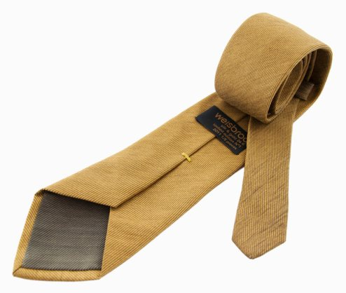 Die Krawatte besteht aus Goldgewebe (Foto: Suitart)