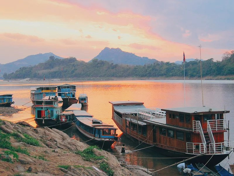 Mekong River surrounded by beautiful sunset colors backpacking Laos.